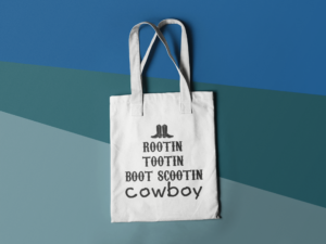 tote-bag-mockup-lying-on-a-three-colors-surface-a15312